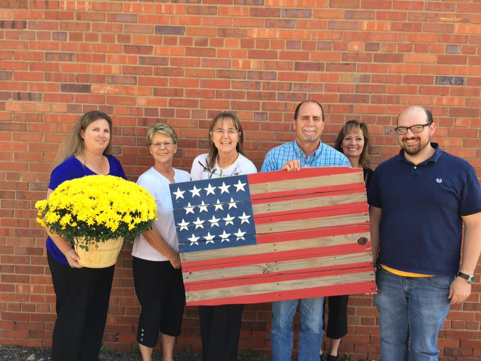 Union Colony Insurance Staff Donating an American Flag Pallet to Helping Heroes Fly